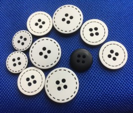 22-L59-13452  Black on White Stitch Button